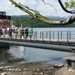 Queen Elizabeth is the one of the first to disembark upon the newly installed Brockhole Visitor Centre pontoon on Lake Windermere.