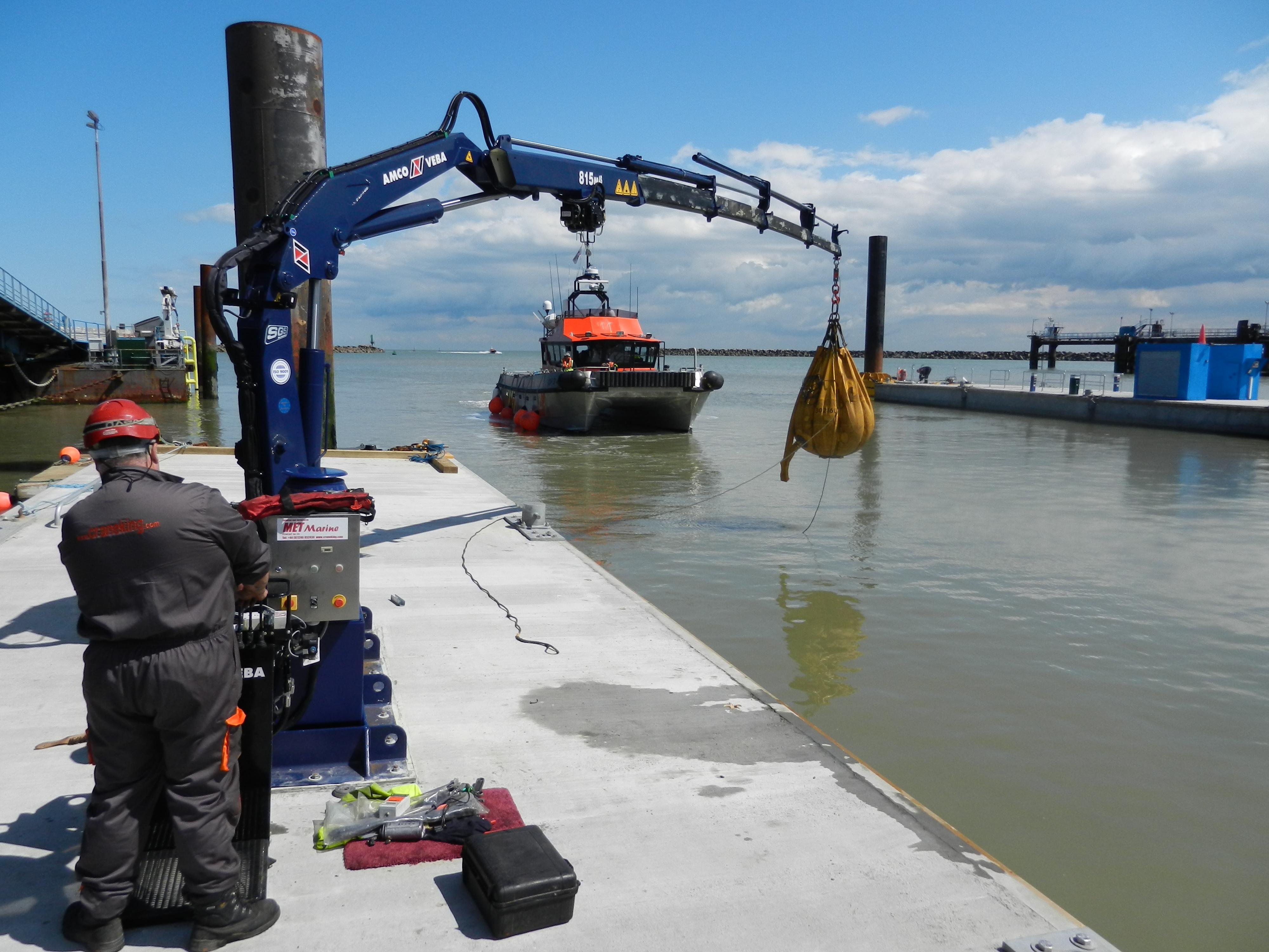 Testing the crane on the 26 metre x 6 metre pontoon